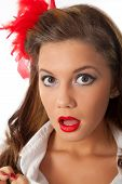 surprised pin-up teenage girl with red feather in her hair poster