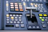 closeup of fader bar and downstream area of broadcast tv switcher poster