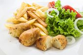 portuguese codfish cake with french fries and vegetables poster