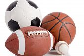 A group of sports balls on a white background including a baseball an American football a basketball and a soccer ball poster