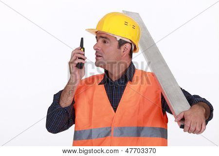 Labourer speaking into a walkie-talkie