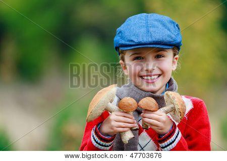 Mushrooms picking, season for mushrooms - lovely girl with picked fresh edible mushrooms