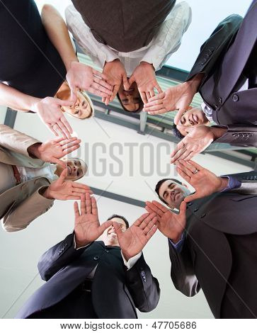 low angle view of business team hands together in circle