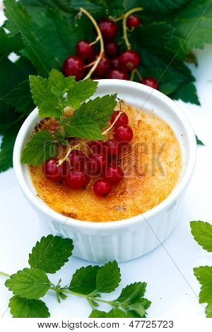 Creme Brulee on the wooden Backgrounf, close up.