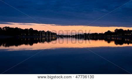 Evening clouds and its reflection in a lake Ada,  Belgrade, Serbia poster