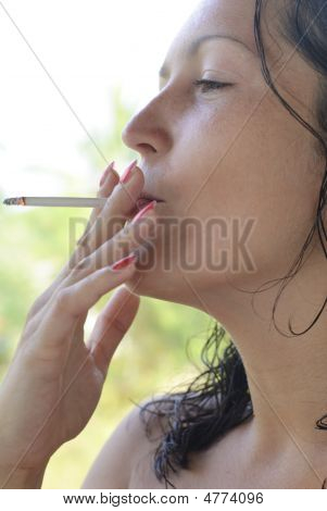 Beautiful Young Woman Smoking Cigarette