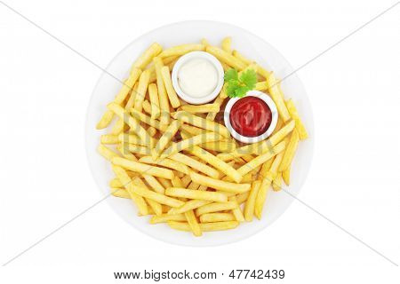Plate with french fries and sauces viewed from above and isolated on white