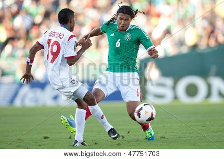 PASADENA, CA - JULY 7: Carlos Pena #6 of Mexico and Alberto Quintero #19 of Panama during the 2013 CONCACAF Gold Cup game between Mexico and Panama on July 7, 2013 at the Rose Bowl in Pasadena, Ca.