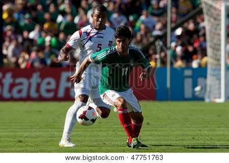 PASADENA, CA - JULY 7: Rafael Marquez #11 of Mexico and Roman Torres #5 of Panama in action during the 2013 CONCACAF Gold Cup game between Mexico and Panama on July 7, 2013 at the Rose Bowl