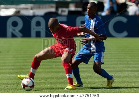 PASADENA, CA - JULY 7: Simeon Jackson #10 of Canada & Daniel Herelle #4 of Martinique during the 2013 CONCACAF Gold Cup game between Canada & Martinique on July 7, 2013 at the Rose Bowl in Pasadena.