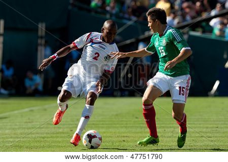 PASADENA, CA - JULY 7: Leonel Parris #2 of Panama and Efrain Velarde #15 of Mexico during the 2013 CONCACAF Gold Cup game between Mexico and Panama on July 7, 2013 at the Rose Bowl in Pasadena, Ca.
