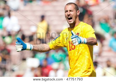 PASADENA, CA - JULY 7: Milan Borjan #18 of Canada during the 2013 CONCACAF Gold Cup game between Canada and Martinique on July 7, 2013 at the Rose Bowl in Pasadena, Ca.