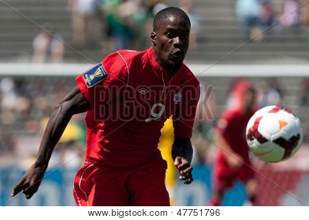 PASADENA, CA - JULY 7: Tosaint Ricketts #9 of Canada chases down the ball during the 2013 CONCACAF Gold Cup game between Canada and Martinique on July 7, 2013 at the Rose Bowl in Pasadena, Ca.
