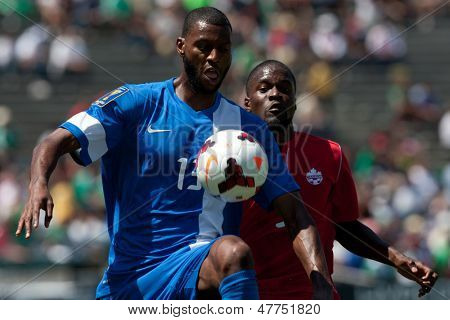 PASADENA, CA - JULY 7: Olivier Thomert #13 of Martinique controls the ball during the 2013 CONCACAF Gold Cup game between Canada and Martinique on July 7, 2013 at the Rose Bowl in Pasadena, Ca.