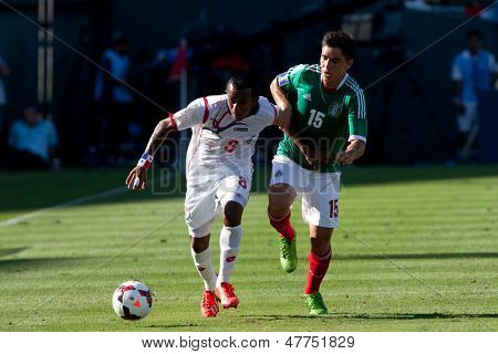 PASADENA, CA - JULY 7: Marcos Sanchez #8 of Panama and Efrain Velarde  #15 of Mexico during the 2013 CONCACAF Gold Cup game between Mexico and Panama on July 7, 2013 at the Rose Bowl in Pasadena, Ca.