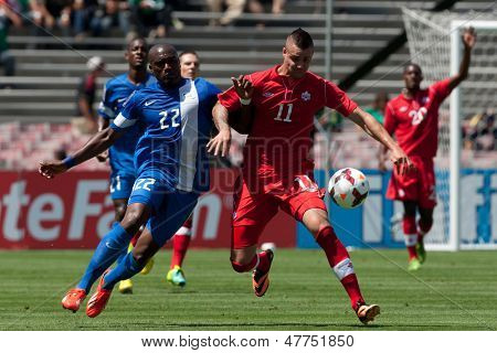 PASADENA, CA - JULY 7: Jean Sylvain Babin #22 of Martinique & Marcus Haber #11 of Canada during the 2013 CONCACAF Gold Cup game between Canada & Martinique on July 7, 2013 at the Rose Bowl.