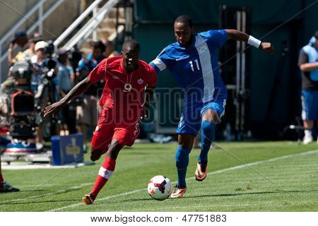 PASADENA, CA - JULY 7: Tosaint Ricketts #9 of Canada & Yoann Arquin #11 of Martinique during the 2013 CONCACAF Gold Cup game between Canada & Martinique on July 7, 2013 at the Rose Bowl in Pasadena.