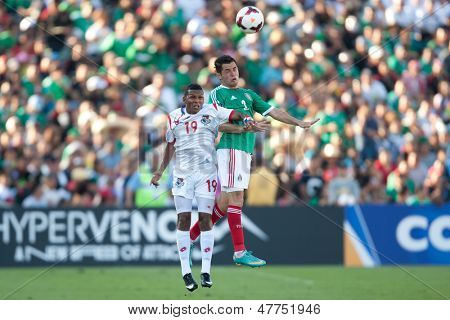 PASADENA, CA - JULY 7: Israel Jimenez #2 of Mexico and Alberto Quintero #19 of Panama during the 2013 CONCACAF Gold Cup game between Mexico and Panama on July 7, 2013 at the Rose Bowl in Pasadena, Ca.
