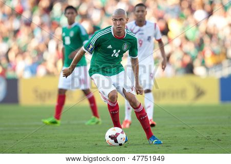 PASADENA, CA - JULY 7: Jorge Enriquez #14 of Mexico during the 2013 CONCACAF Gold Cup game between Mexico and Panama on July 7, 2013 at the Rose Bowl in Pasadena, Ca.