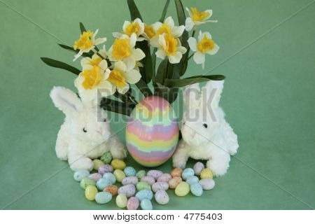 Easter Bunnies With Striped Puzzle Egg And Flowers