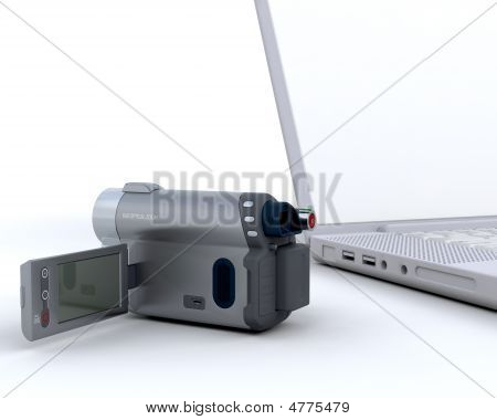 3D Handy Cam Next To A Laptop