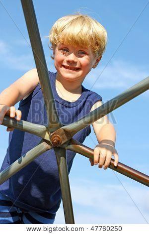 Child Climbing Jungle Gym