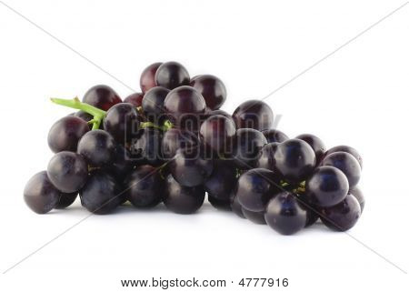 Bundle Of Grapes Isolated On White Background