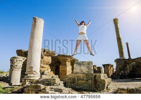 Girl In Jump Amid The Ruins Of Carthage In Tunisia