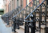 Brownstone Apartment steps in the Chelsea neighborhood of New York City. poster
