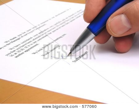 Staff Manager Signing A Letter
