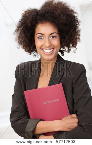 African American Woman Clutching A Red File