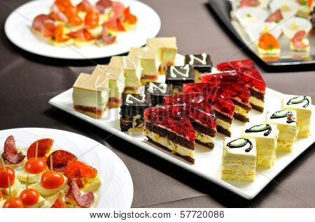 Party table with cakes and canapes
