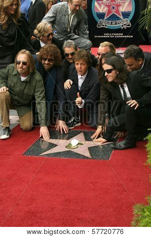 Paul McCartney and Olivia Harrison with family and friends at the ceremony posthumously honoring George Harrison with a star on the Hollywood Walk of Fame. Vine Boulevard, Hollywood, CA. 04-14-09