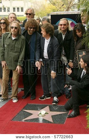 Paul McCartney with Olivia Harrison with family and friends  at the ceremony posthumously honoring George Harrison with a star on the Hollywood Walk of Fame. Vine Boulevard, Hollywood, CA. 04-14-09