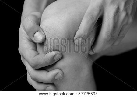 The man is touching the knee joint due to acute pain poster