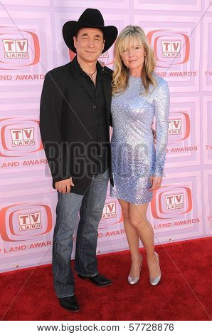 Clint Black and Lisa Hartman at the 2009 TV Land Awards. Gibson Amphitheatre, Universal City, CA. 04-19-09