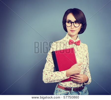Portrait of Trendy Hipster Girl with a Book