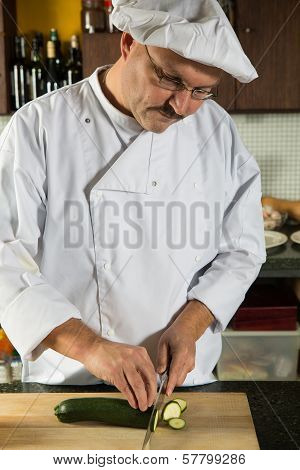 Male Chef Cutting Vegetables