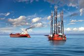 Oil rig and tanker ship on offshore area. poster