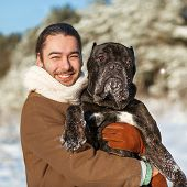 Man and dog friendship forever in winter forest. poster