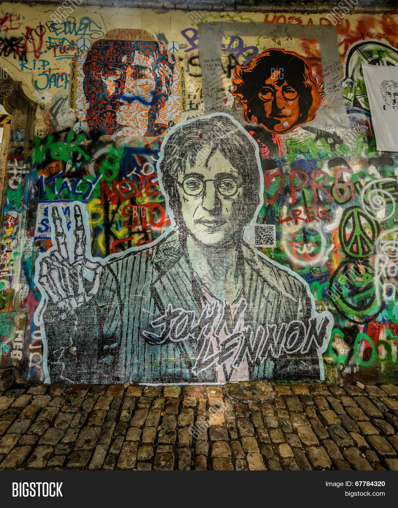 Prague czech republic may 24the lennon wall since the 1980s filled with john lennon inspired graffiti and pieces of lyrics from beatles songs on may 24