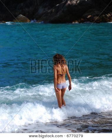 Girl In The Sea Waves