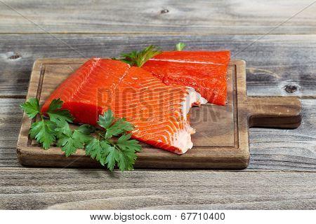 Fresh Red Salmon On Wooden Server