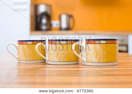 Three Orange Cups