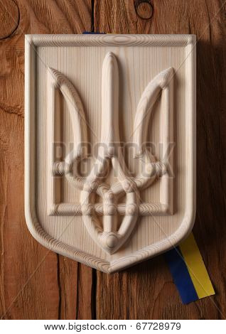 Coat Of Arms Of Ukraine (state Emblem, National Ukrainian )  Carved From A Tree On A White Backgroun