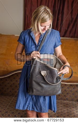 Blonde Woman With Gray Leather Purse