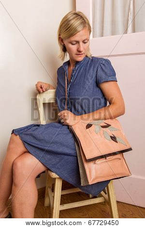 Blonde Woman With Pink Purse