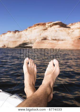 Mans Feet Hanging Over Side Of Boat