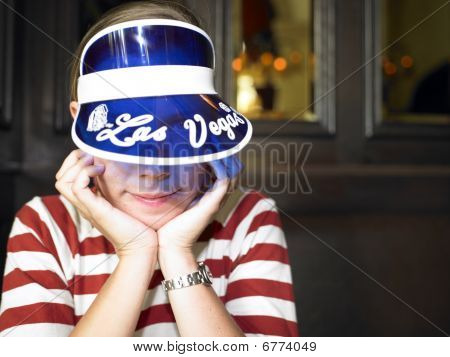 Young Woman With Blue Visor Smiling