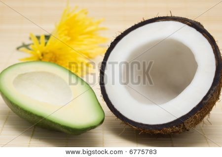 Coconut, Avocado, Yellow Flowers On A Rug.